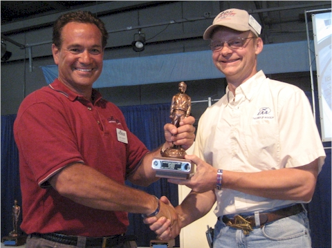 Jay Sabot receives Lindy at OSH 2011